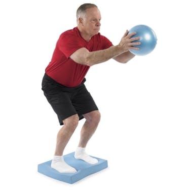 Man balancing while holding small ball