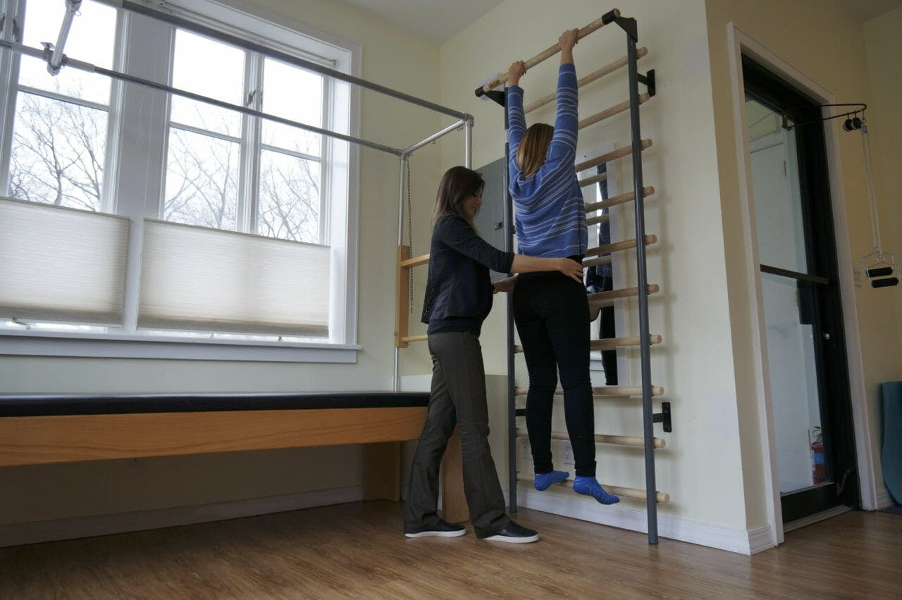 Patient Using Flex Bar with Moussia