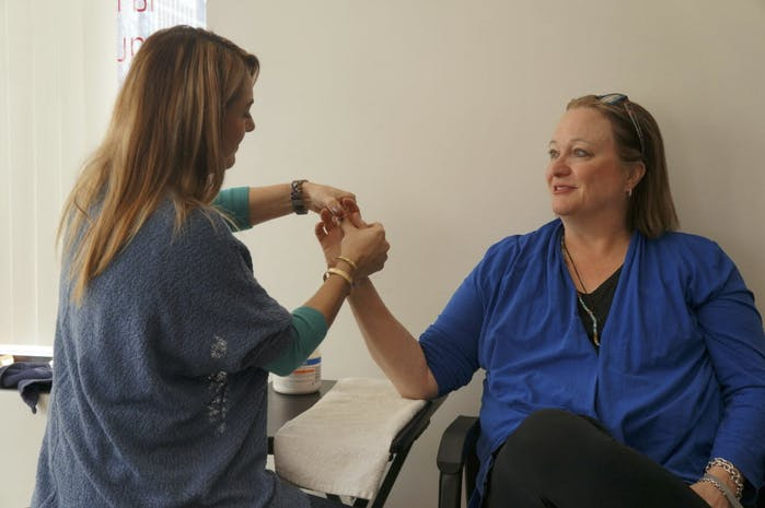 Allison Masi-Sanchez, OTRL, CHT treating patient