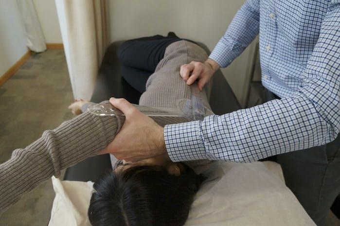 Edward Umheiser, DPT measuring shoulder mobility