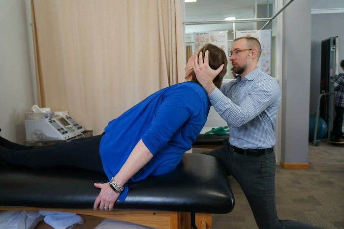 Edward Umheiser, DPT treating patient with Vestibular Rehabilitation Therapy