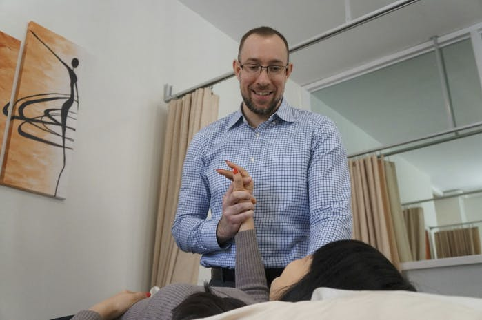 Edward Umheiser, DPT treating patient