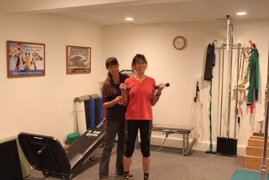 woman exercising with PT supervision