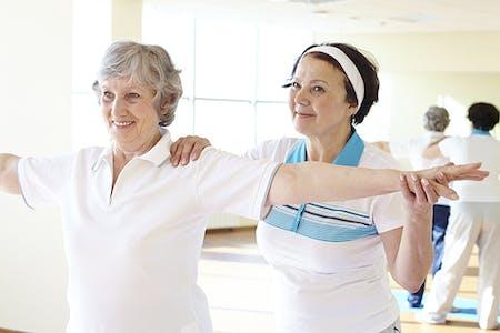 Photo of female doing shoulder exercises