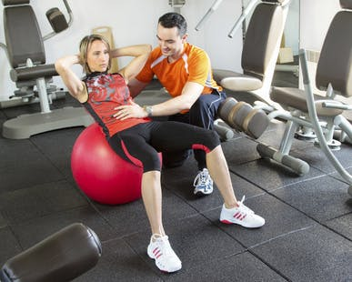 image of a lady and her personal trainer