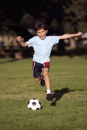 image of a kid playing soccer