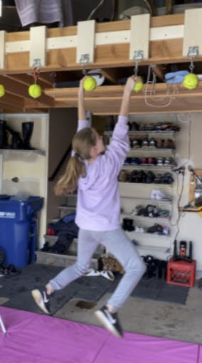 Caroline doing Ninja Gym exercise in her garage