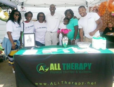 Description: Photo of Peach Festival Volunteers, Stephanie Lord (3rd right), Nick Ryan, Dr. Lord Ryan (green), Kendall Daniels
