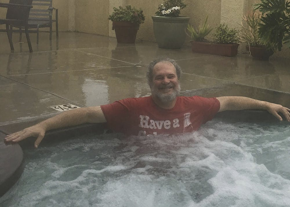 Johnny Ace Palmer enjoying the jacuzzi in the rain. Great smile!