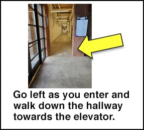 Go left as you enter and walk down the hallway towards the elevator.